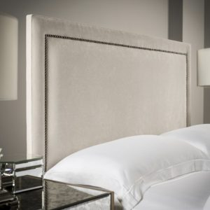 Floor standing Milly upholstered headboard with studded detailing
